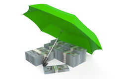 Packs of dollars covered by green umbrella Stock Photo