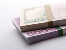 Packs of dollars and euros Royalty Free Stock Photos