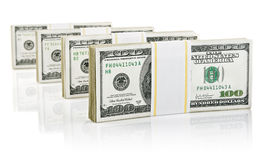 Packs with dollars money. On white background Royalty Free Stock Images