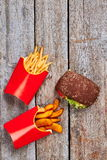 Packs with fries near burger. Stock Image