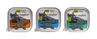 3 Packs of Marks and Spencer Complete adult cat food 0n a white background. Stock Photos