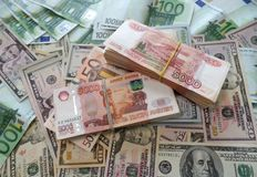 Packs million of Russian rubles with dollars and euro. Wealth Money in bank, banknotes on the table stock photography