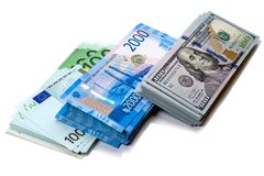 Packs of money in three currencies. Bundles of money - euro, russian rubles and dollars Stock Image