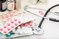 Packs of pills and a stethoscope Stock Images