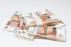 Packs of ruble. Notes randomly lie on a white background stock photography