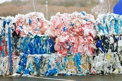 Packs and Stocks of Wrapped Scrap Plastic Dedicated for Eco Recycling in front of a Recycling Factory royalty free stock photography