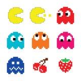 Pacman e iconos del juego de ordenador de los años 80 de los fantasmas fijados imagen de archivo