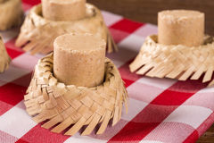 Pacoca - brazilian candy of ground peanut with wicker hat of festivity festa junina decoration. Pacoca - brazilian candy of ground peanut with wicker hat of Stock Image