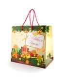 Pacote do Natal com cumprimento isolado no branco Fotos de Stock Royalty Free