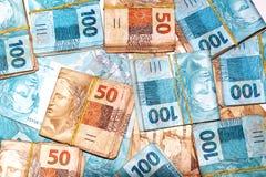 Pacotes brasileiros do dinheiro Foto de Stock