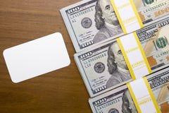 Pacotes de cem notas de dólar Imagens de Stock