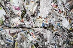 Pacotes empilhados dos jornais Fotografia de Stock