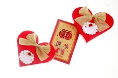 Pacotes vermelhos e empacotamento dos doces foto de stock