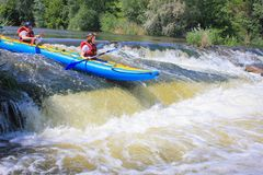 Pacuare River, Costa Rica - March 14 2019: Young couple enjoy white water kayaking on the river. Pacuare River,  Costa Rica - March 14 2019: Young couple enjoy royalty free stock photo