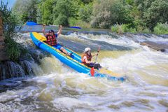 Pacuare River, Costa Rica - March 14 2019: Young couple enjoy white water kayaking on the river. Pacuare River,  Costa Rica - March 14 2019: Young couple enjoy stock photo
