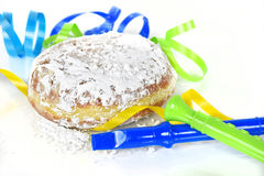 Paczki with party horns and ribbons on white Stock Photos