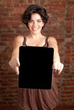 Pad. Brunette woman holding new electronic tablet touch pad computer pc Royalty Free Stock Photos