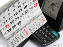 Pad, calculator on calendar sheets Stock Photos