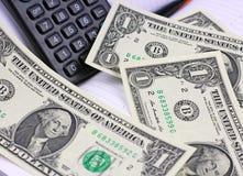 Pad, calculator , dollars on calendar sheets Stock Photo