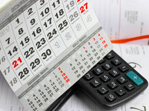 Free Pad, Calculator On Calendar Sheets Royalty Free Stock Images - 40796999