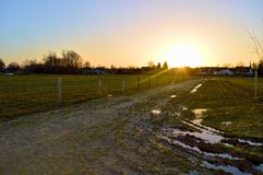 Pad and fields with sunrise Royalty Free Stock Image