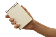 Pad in hand. Male hands holding pad of paper isolated on a white background stock photo