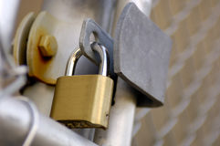 Pad Lock. On a Chain link Fence Stock Photo