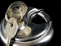 Pad Locks and Keys. A Stainless Steel pad lock and keys on a black backdrop Stock Photos