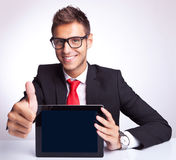 This pad is ok!. Office worker holding blank digital tablet pad and making ok hand gesture Royalty Free Stock Photo