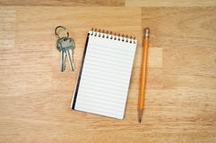 Pad of Paper, Pencil and Keys Royalty Free Stock Image