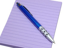Pad and Pen. Purple Pad and Blue Pen Royalty Free Stock Image