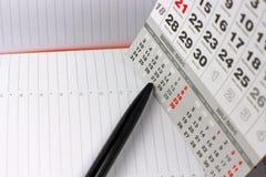 Pad, pencil  on calendar sheets Stock Photos