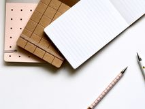 Pad With Pens on Table stock images