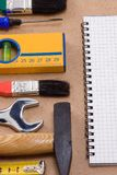 Pad and set of tools Royalty Free Stock Photo