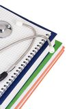 Pad and stethoscope on books Stock Image