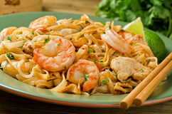 Pad Thai. A delicious plate of Pad Thai with shrimp and chicken garnished with cilantro and lime Stock Photography
