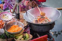 Pad Thai. Cooking on the boat in Amphawa floating market Stock Images