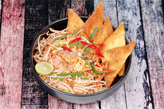 Pad Thai with Crisy wonton and chicken ,bean sprouts topped halv Stock Photo