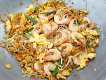 Pad thai. Delicious rice noodles Thai call `Pad Thai` topping with shrimp or prawns in a pan. Thai food royalty free stock images