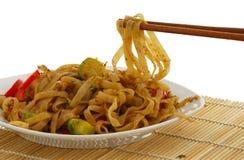 Pad Thai dish on straw pad with chopsticks Royalty Free Stock Image