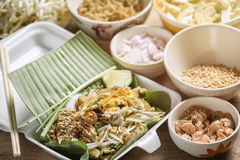 Pad-Thai Food of Thailand for Take home Arrange on a wooden tabl. E Royalty Free Stock Images