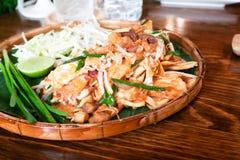 Pad Thai with fried wonton, Thai fusion food served on threshing. Basket stock photo