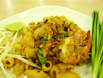 Pad thai macaroni with prawn. Asian - Thai Italian fusion food mix, Stir fried macaroni with tamarind sauce and fresh shrimps & x28;prawns& x29; served with bean Royalty Free Stock Photos