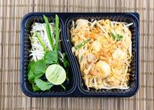 Pad thai noodles Take away food in plastic black box , Thai food style stock photo