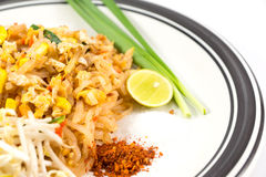 Noodles pad Thai. Isolated on white background Stock Photos