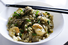 Pad thai with seafood. Pad Thai with shripms and baby octopuses stock photography