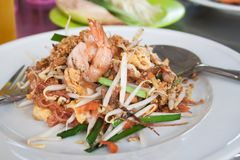 Pad Thai shrimps on white plate, Favorite Thai Food. Thailand popular dish royalty free stock photography