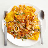 Pad thai stir fried noodles of thailand on white dish Royalty Free Stock Photography
