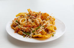 Pad thai stir fried noodles of thailand on white dish Stock Images