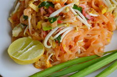 Pad Thai stir fried rice noodle with egg and vegetable on dish. Pad Thai stir fried rice noodle with egg and vegetable on white dish royalty free stock photos
